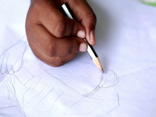 kids drawing paper in pencil