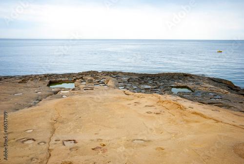 Evaporation ponds at the coast, Malta