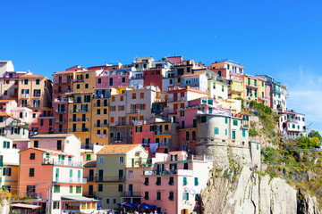 Multi-colored houses in Manarol's fishing  village. Italy