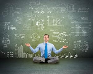 business man meditating on floor