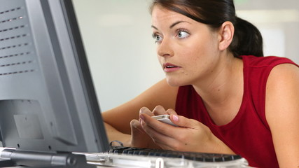 Close up of young businesswoman at desk with computer