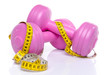Pink dumbells with a tape measure