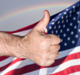 Thumb  up sign against of USA flag