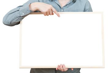 finger points on blank bulletin board in hand