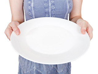 woman holds empty white plate