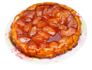 apple pie Tatin on plate isolated on white