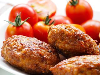 Homemade patties and cherry tomatoes