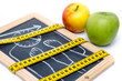 canvas print picture - Concept of weight loss, apples and a tape measure