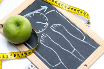 Concept of weight loss with an apple and a tape measure