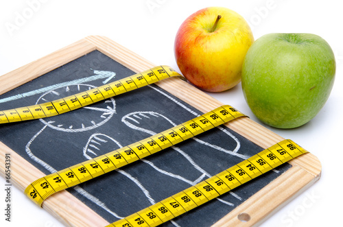 canvas print picture Concept of weight loss, apples and a tape measure