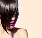 Beauty model girl with fashion haircut. Stylish fringe