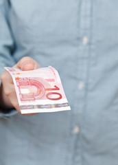 ten euro banknote in hand