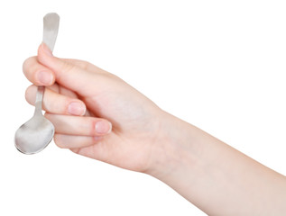 hand with empty teaspoon isolated