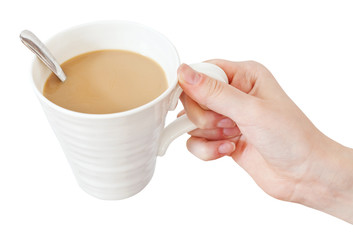 hand holds mug of coffee with milk