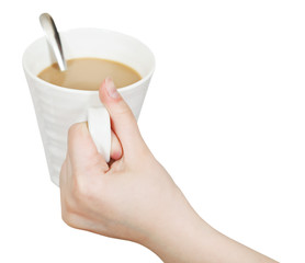 white mug with milk coffee in hand isolated