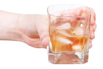hand holds whiskey on ice in glass isolated
