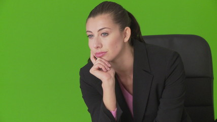 Closeup portrait of serious young businesswoman sitting in offic