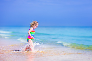 Little girl running on a beach