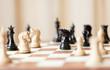 Leinwanddruck Bild - Chess pieces set on a chessboard