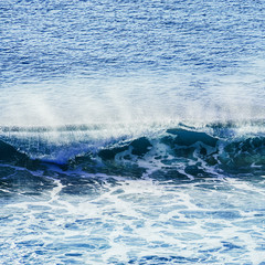 swirled blue colored ocean wave