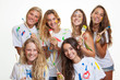 group of teenagers having fun with paint
