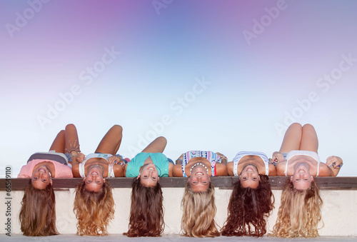 happy teens with long healthy hair laying upside down. - 66549110
