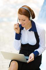 Customer service representative, businesswoman on phone