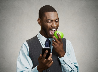 Busy life businessman. Corporate man holding smartphone, eating