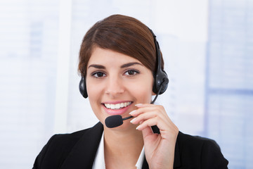 Confident Businesswoman Wearing Headset In Office