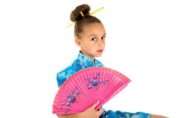 Cute girl in Chinese dress holding a fan
