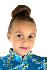 Adorable girl wearing a Chinese dress with hair in a bun