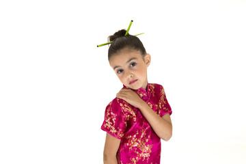 Shy young girl wearing a Chinese cheongsan dress