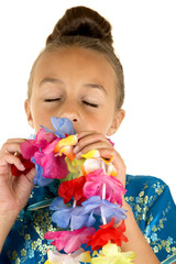 beautiful young girl smelling a paper lei eyes closed