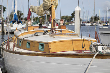 White wood  sailboat in harbor marina