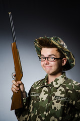 Funny soldier against the dark background