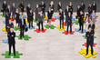 Business People Standing On Jigsaw Pieces