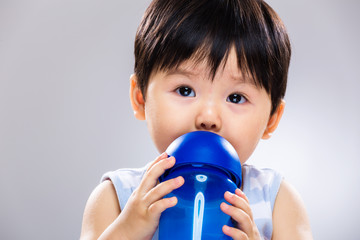 Baby boy drink with water bottle close up