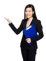 Business woman with note pad and hand present something