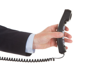 Businessman Holding Telephone Receiver