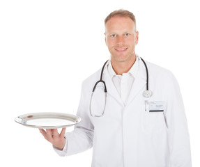 Doctor Holding Empty Tray