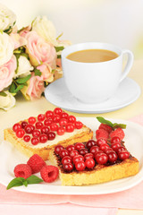 Delicious toast with cranberries on table on light background
