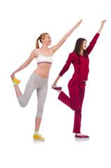 Pair of women doing exercises on white