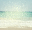 background of blurred beach and sea waves with bokeh lights, vin