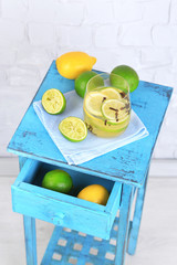 Fresh summer drink with lime and cloves in glass,