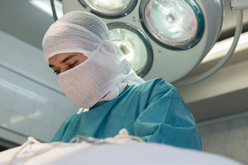 a young surgeon in the operating room