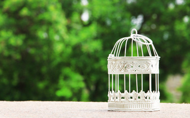 Empty white vintage birdcage  outdoors