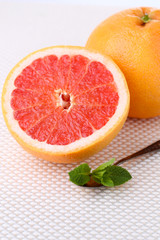 Half of grapefruit on light background