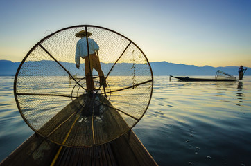 Silhouette fishermen in Inle Lake at sunrise, Myanmar
