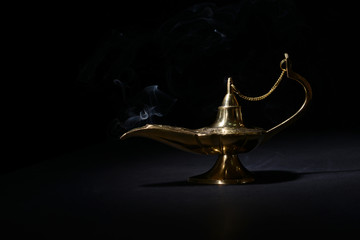 Magic lamp isolated on black