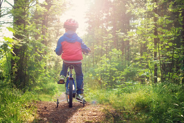 Boy on bike in the forest